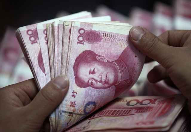 Người dân Trung Quốc đổ xô rút tiền khỏi ngân hàng vì tin đồn thất thiệt - Ảnh 1.
