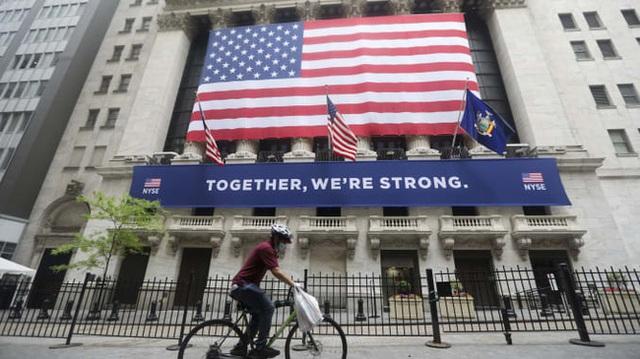 FED giữ nguyên lãi suất và cảnh báo tác động của COVID-19 tới sự phục hồi kinh tế Mỹ - Ảnh 1.