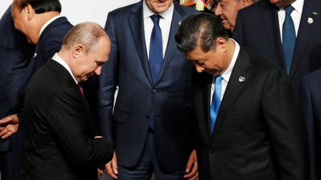 Nga – Trung Quốc loại bỏ dần đồng USD trong các giao dịch thương mại - Ảnh 1.