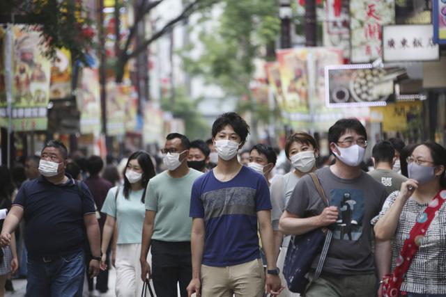 Nhật Bản sẽ yêu cầu các cửa hàng rút ngắn thời gian kinh doanh - Ảnh 1.