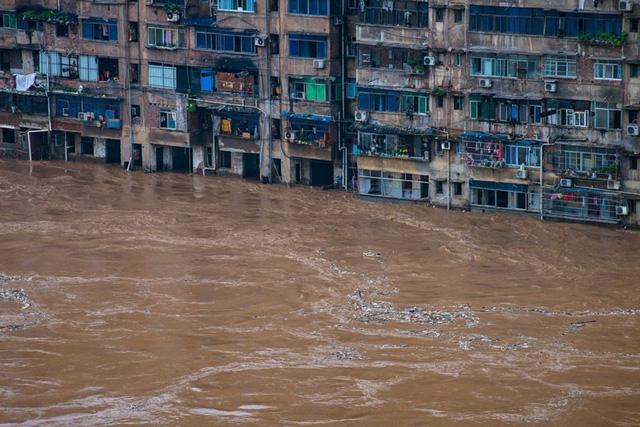 Trung Quốc nâng mức phản ứng khẩn cấp đối phó lũ lụt - Ảnh 1.