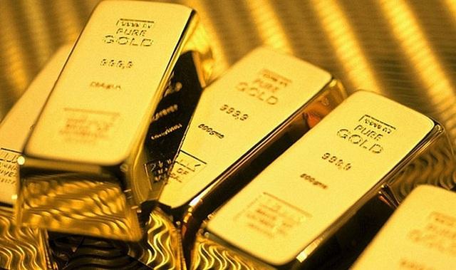 Vượt ngưỡng 1.800 USD/ounce, giá vàng lên đỉnh 9 năm - Ảnh 1.