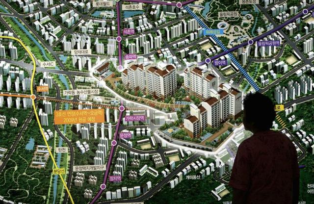 Quan chức cấp cao Hàn Quốc được yêu cầu bán bớt nhà để làm gương trước dân - Ảnh 2.