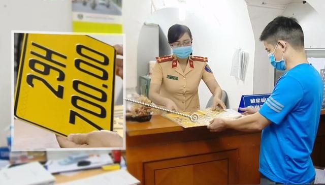 Ngày đầu thực hiện cấp biển số xe màu vàng tại Hà Nội - Ảnh 1.