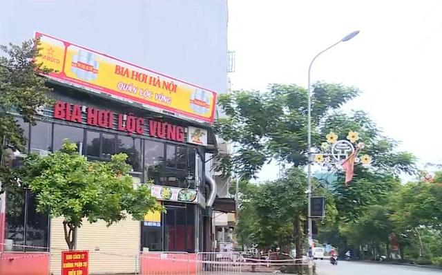 Phong tỏa quán bia ở Thanh Trì liên quan đến ca nghi nhiễm COVID-19 - Ảnh 1.