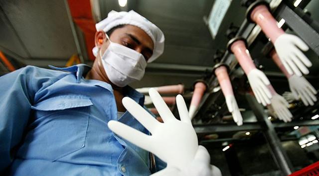 Nhóm cổ phiếu công ty sản xuất găng tay tăng mạnh thời COVID-19 - Ảnh 1.