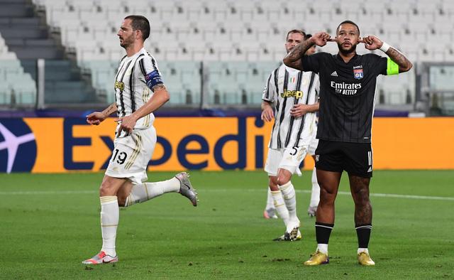 Ronaldo lập cú đúp, Juventus vẫn bị loại khỏi Champions League - Ảnh 1.