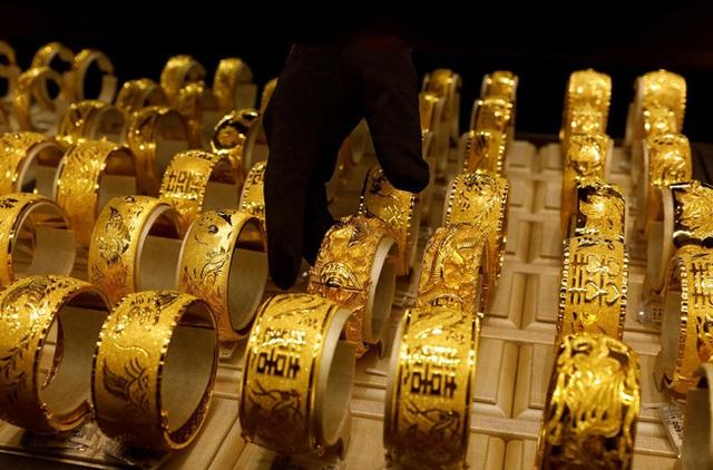Giá vàng châu Á lên mức cao nhất trong gần 2 tuần - Ảnh 1.