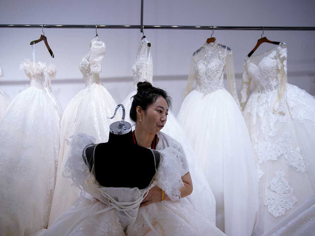 """Thủ phủ váy cưới """"ế ẩm"""" vì COVID-19 - Ảnh 1."""