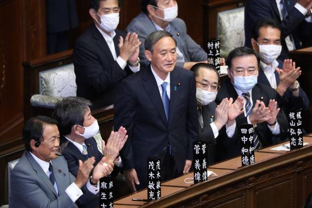 Kế thừa và ghi dấu ấn - Thách thức với tân Thủ tướng Nhật Bản - Ảnh 1.