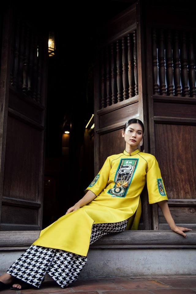 NTK Cao Minh Tiến đưa nghệ thuật Bài Chòi vào áo dài - Ảnh 3.