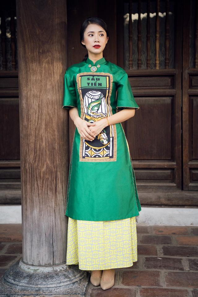 NTK Cao Minh Tiến đưa nghệ thuật Bài Chòi vào áo dài - Ảnh 1.