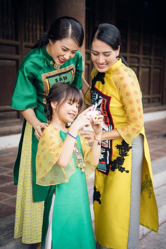 NTK Cao Minh Tiến đưa nghệ thuật Bài Chòi vào áo dài - Ảnh 2.
