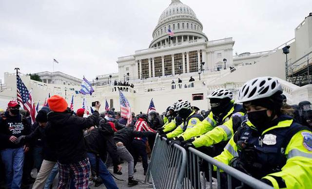 FBI cảnh báo biểu tình vũ trang trước lễ nhậm chức của ông Joe Biden - Ảnh 1.