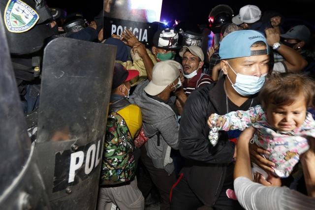Đại dịch khiến số người di cư trên toàn cầu giảm khoảng 2 triệu trường hợp - Ảnh 2.