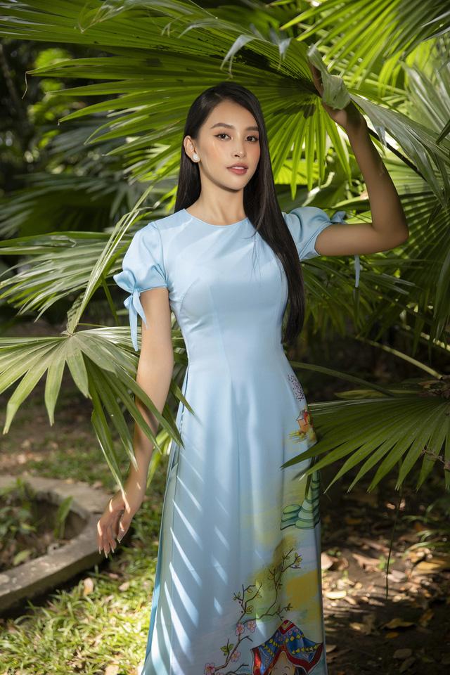 Hoa hậu Tiểu Vy đẹp tinh khôi với áo dài Tết - Ảnh 4.