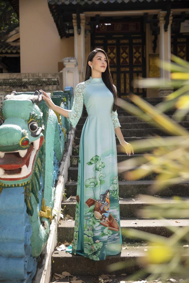 Hoa hậu Tiểu Vy đẹp tinh khôi với áo dài Tết - Ảnh 11.