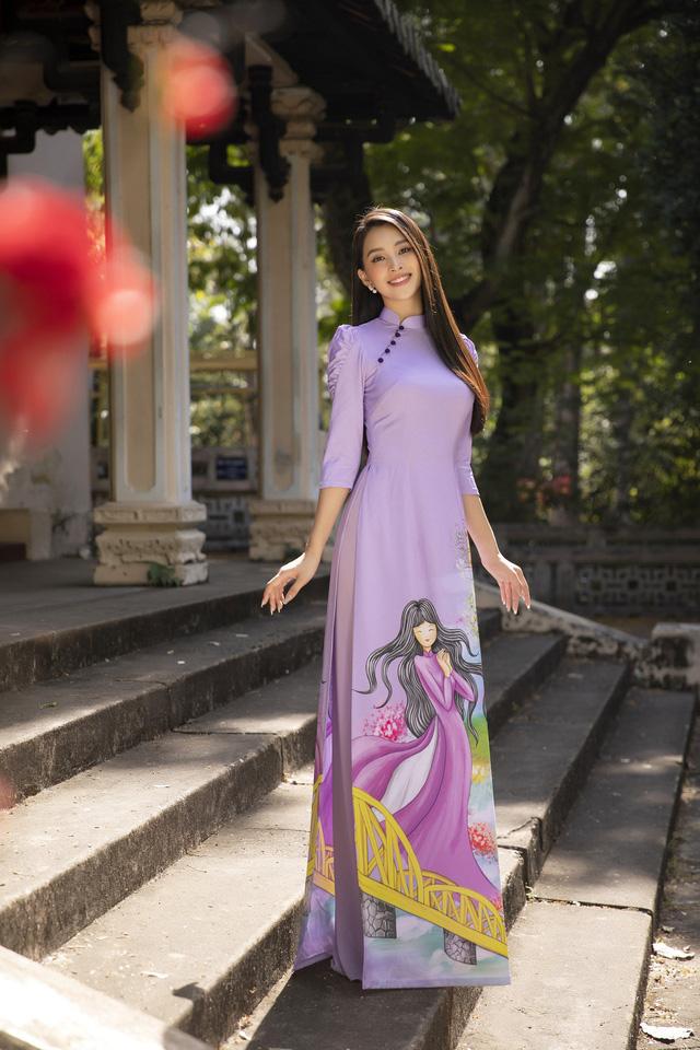 Hoa hậu Tiểu Vy đẹp tinh khôi với áo dài Tết - Ảnh 12.