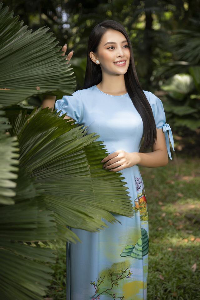 Hoa hậu Tiểu Vy đẹp tinh khôi với áo dài Tết - Ảnh 8.