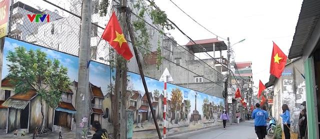 Con đường bích họa chào mừng Đại hội Đảng tại Hà Nội - Ảnh 1.