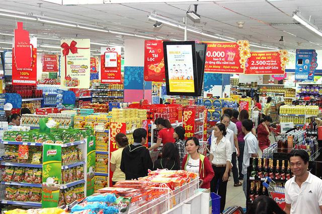 Mạnh tay khuyến mãi, các doanh nghiệp bán lẻ kích cầu mua sắm Tết Tân Sửu - Ảnh 2.