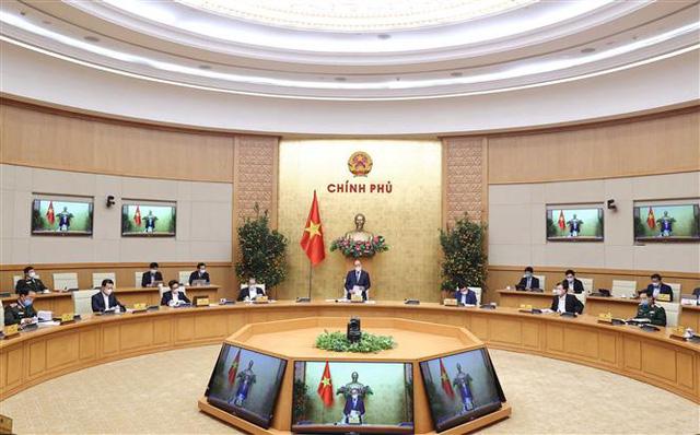 Thủ tướng: Không để tháng Giêng là tháng ăn chơi, vừa chống dịch vừa thực hiện Nghị quyết Đại hội XIII của Đảng - Ảnh 1.