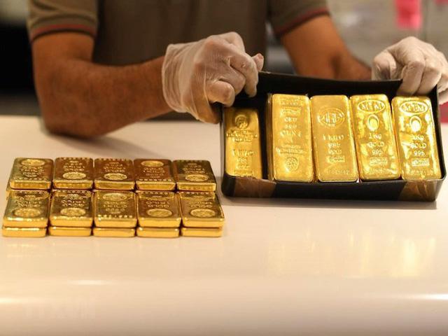 Giá vàng cắm đầu lao dốc sau ngày vía Thần Tài - Ảnh 1.