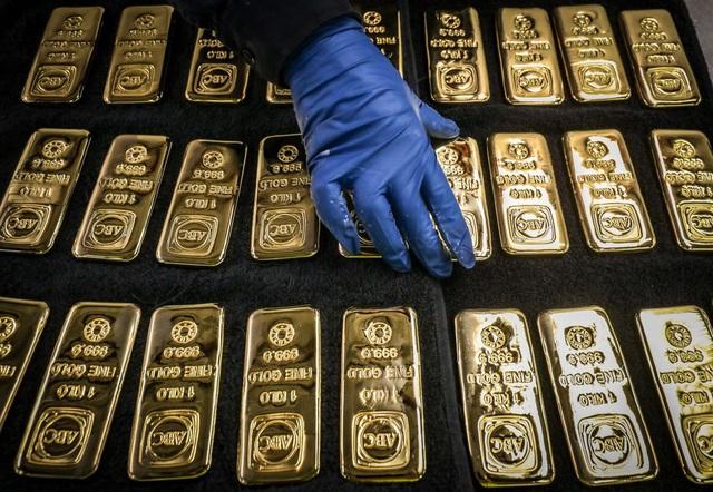 Giá vàng tăng dựng đứng ngày giáp Tết - Ảnh 1.
