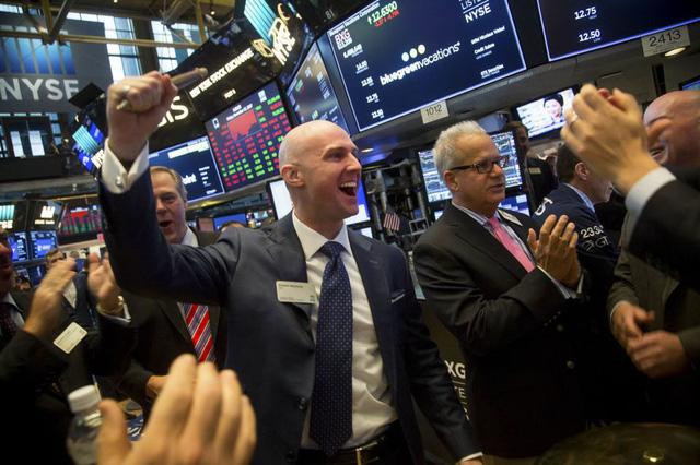 Dow Jones tăng hơn 600 điểm - ảnh 1