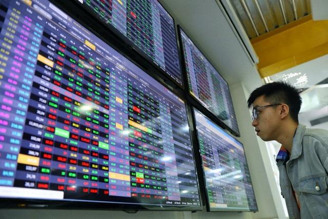 Nhà đầu tư nhỏ lo ngại bị loại khỏi thị trường chứng khoán - Ảnh 1.
