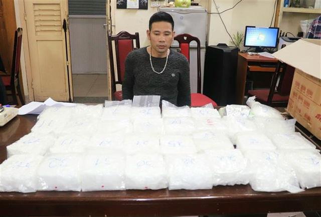 Triệt phá băng nhóm tội phạm mua bán, vận chuyển trái phép gần 60 kg ma túy tổng hợp - Ảnh 4.