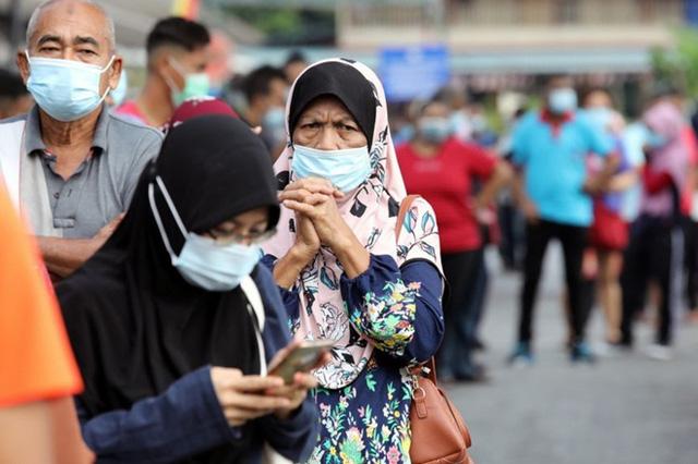 Malaysia cấm đi lại giữa các quận trên toàn quốc từ ngày 10/5 - Ảnh 1.
