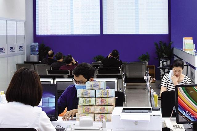 Kiểm soát chặt tín dụng đối với bất động sản, chứng khoán - Ảnh 1.