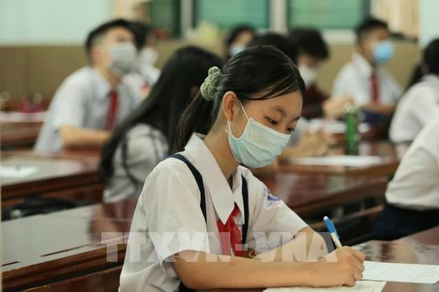 Bộ GD&ĐT đề nghị giữ ổn định mức học phí trong năm học mới 2021-2022 - Ảnh 1.