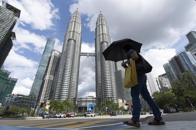Singapore và Malaysia căng mình ứng phó với dịch COVID-19 - Ảnh 2.
