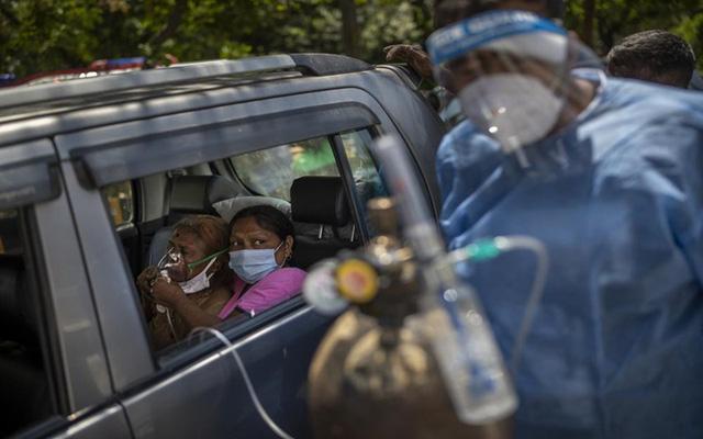 Nhiều nước đẩy mạnh tiêm vaccine, Nhật Bản vượt 6.000 ca nhiễm mới/ngày - Ảnh 1.