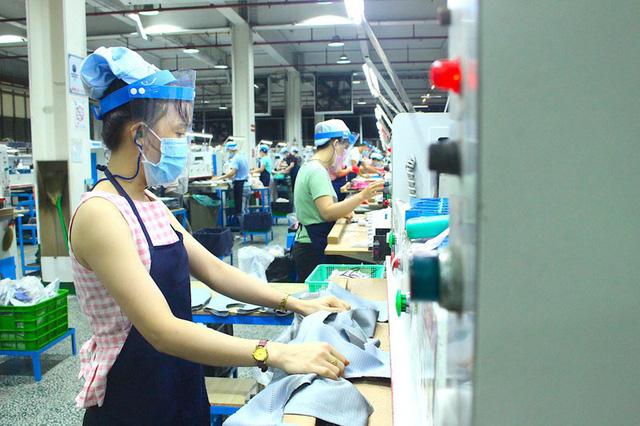 WB: Kinh tế Việt Nam chống chịu tốt với đợt dịch mới - Ảnh 1.