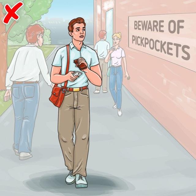 10 mẹo hay để bảo vệ tài sản của bạn khỏi kẻ móc túi - Ảnh 6.