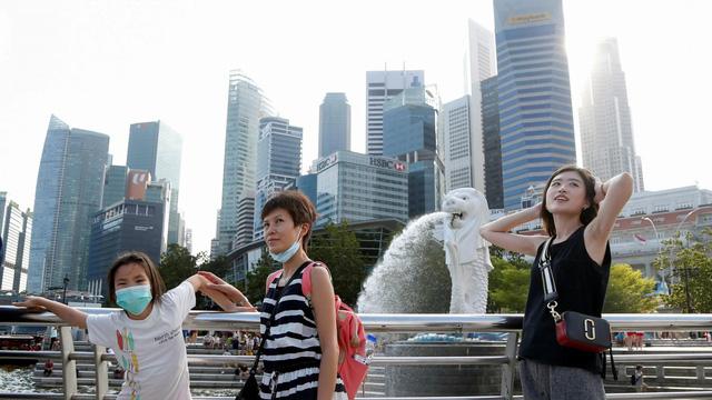 Singapore nới lỏng các quy định giãn cách phòng dịch COVID-19 - Ảnh 1.