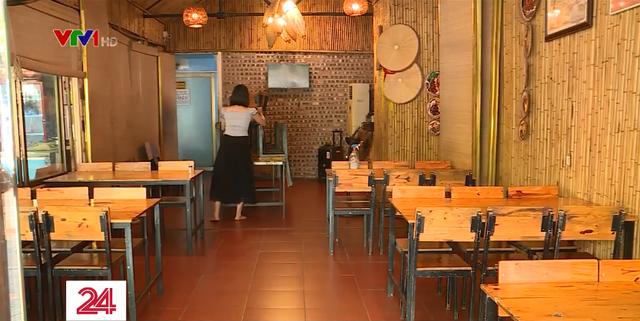 Ngày đầu Hà Nội nới lỏng giãn cách xã hội, hàng quán tuân thủ 5K - Ảnh 1.