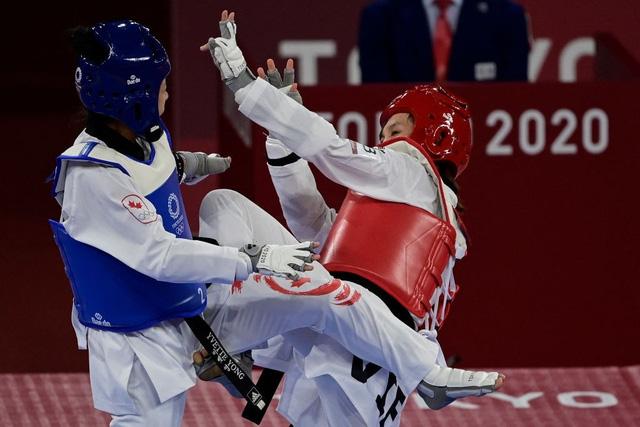 Kim Tuyền thắng đậm, tiến vào tứ kết Taekwondo Olympic Tokyo 2020 - Ảnh 2.
