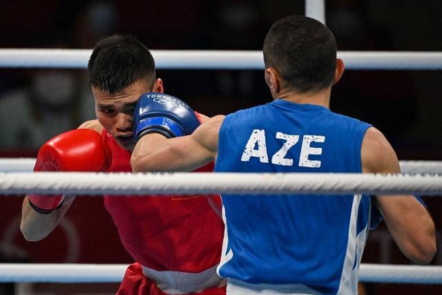 Nguyễn Văn Đương lập kỳ tích cho Boxing Việt Nam ở Olympic sau 33 năm - Ảnh 2.