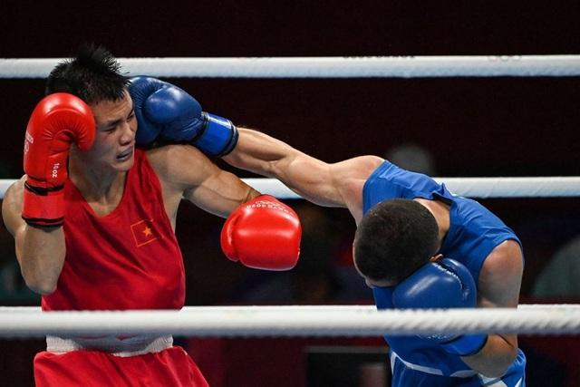 Nguyễn Văn Đương lập kỳ tích cho Boxing Việt Nam ở Olympic sau 33 năm - Ảnh 3.