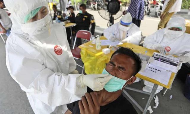Các nước ASEAN lập kỷ lục số ca mắc COVID-19/ngày, Indonesia có số người nhiễm mới cao nhất thế giới - Ảnh 2.