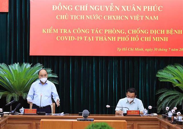 Chủ tịch nước: TP Hồ Chí Minh phải tiếp tục thực hiện nghiêm giãn cách xã hội ở mức cao - Ảnh 1.
