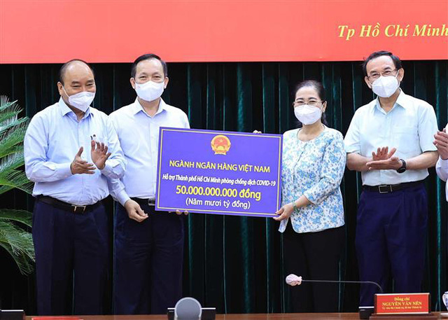 Chủ tịch nước: TP Hồ Chí Minh phải tiếp tục thực hiện nghiêm giãn cách xã hội ở mức cao - Ảnh 2.