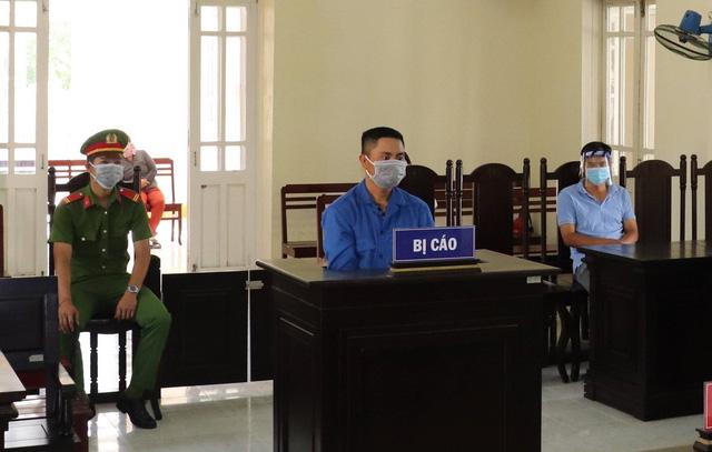 Phạt tù hai đối tượng vi phạm quy định phòng, chống dịch COVID-19 - Ảnh 1.