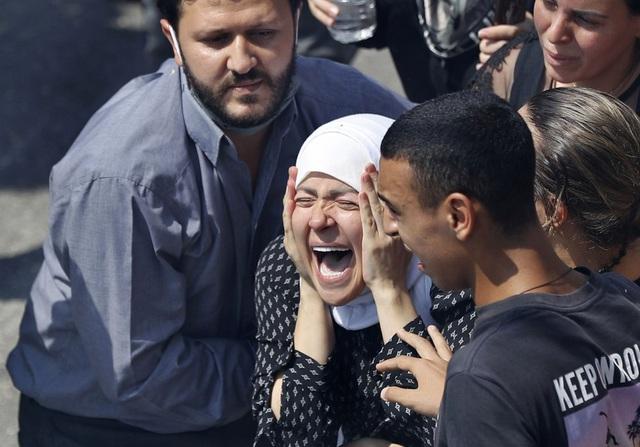 Một năm sau thảm họa ở cảng Beirut, những vết thương để lại vẫn chưa lành - Ảnh 13.