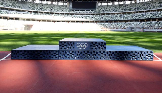 Bảo vệ môi trường tại Olympic Tokyo 2020 với bục nhựa, huy chương kim loại tái chế, giường bìa cứng - Ảnh 1.