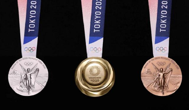 Bảo vệ môi trường tại Olympic Tokyo 2020 với bục nhựa, huy chương kim loại tái chế, giường bìa cứng - Ảnh 2.